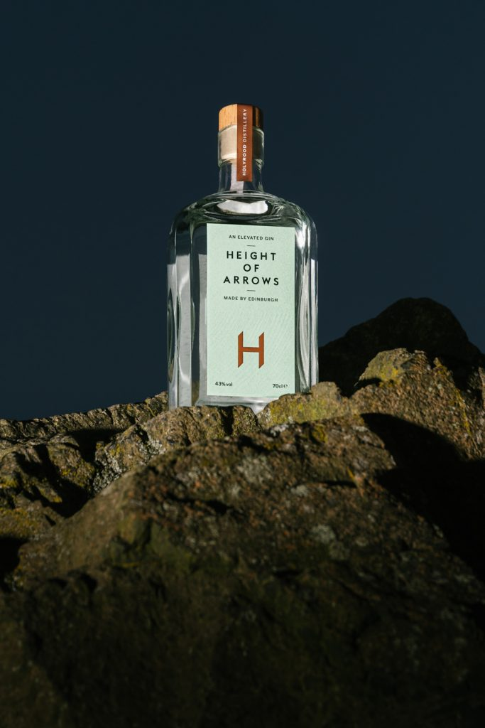 Height of Arrows Gin bottle on top of Arthur's Seat at night